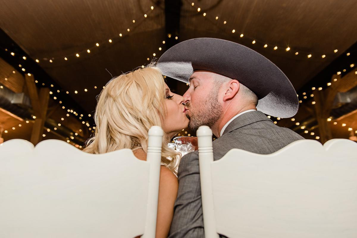 Sweet kisses at the reception