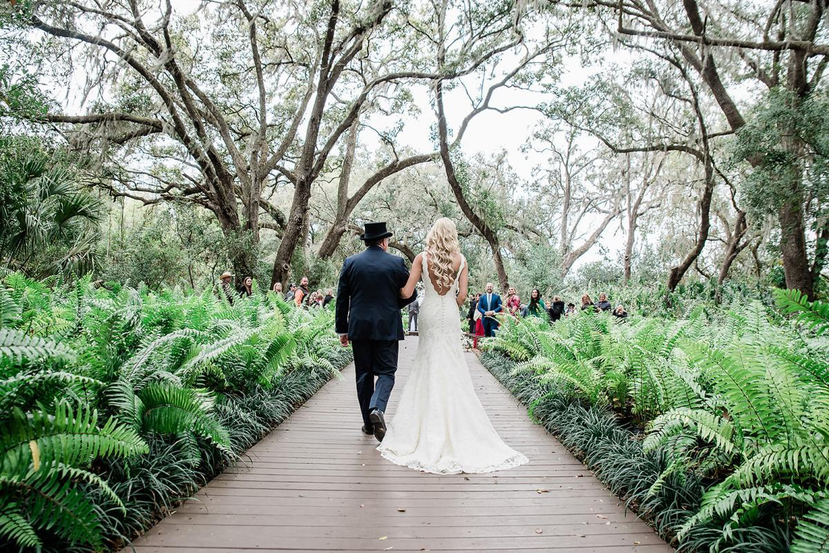 Shayla walking down the aisle at the Enchanted Forest