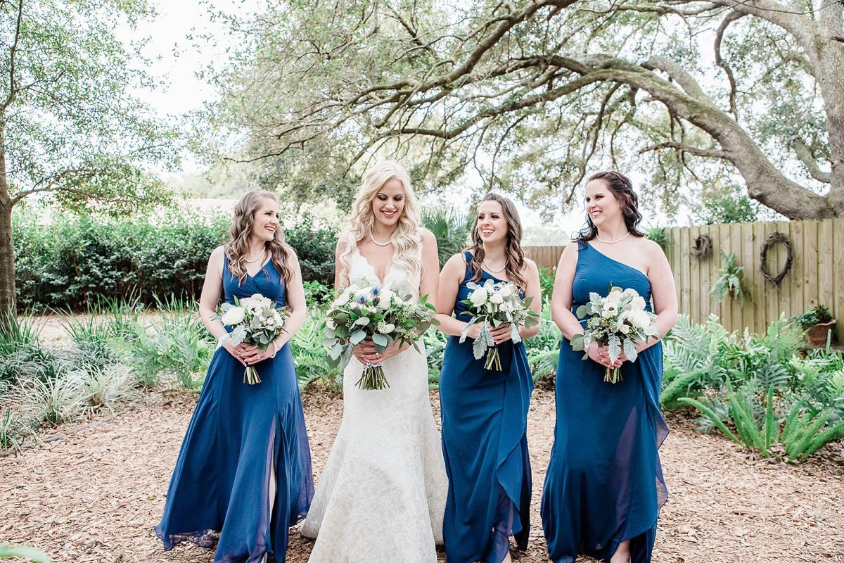 Shayla and her bridesmaids who are dressed in navy blue dresses