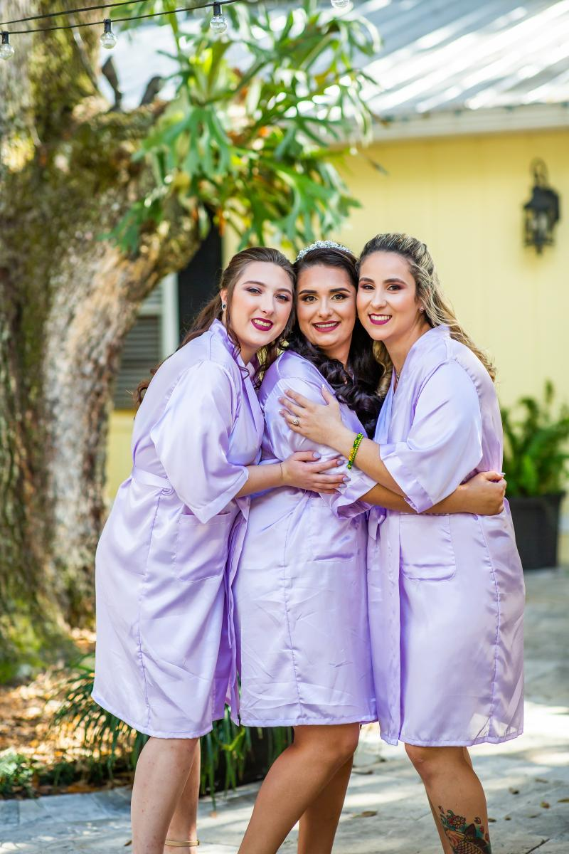 Sophia and her bridesmaids in lilac wedding robes
