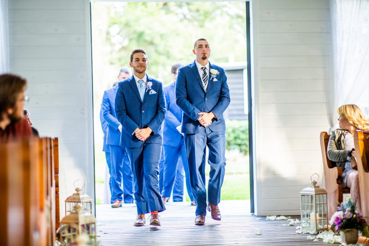 Zachary walking down the aisle with his groomsmen