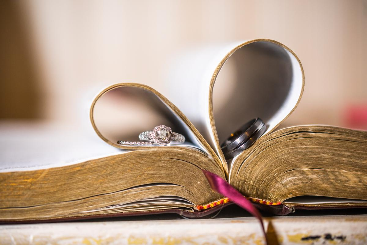 Photograph of the couples wedding rings in a Bible