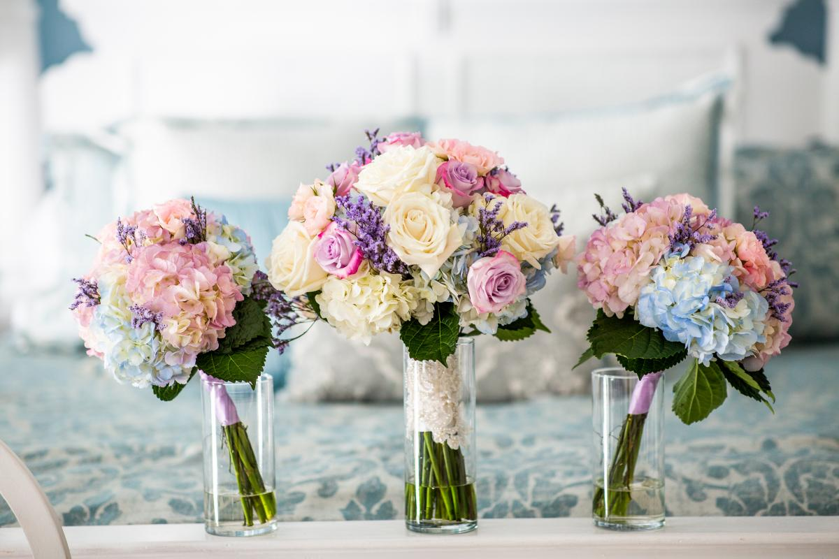Lilac and light blue wedding bouquets by Alta Fleura