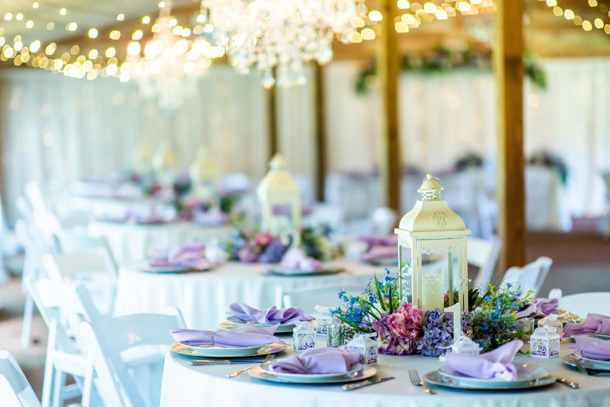 Lilac and light blue whimsical wedding reception tables
