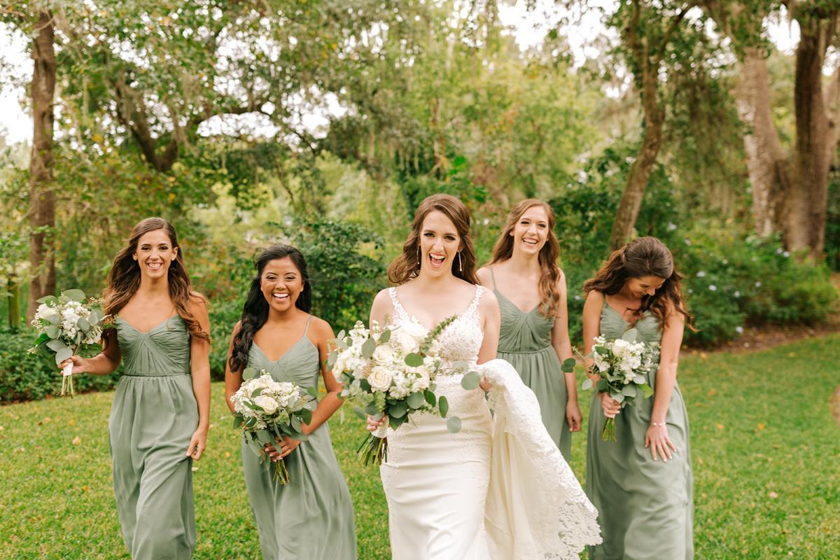 Caitlin's bridesmaids are wearing sage green dresses by Sorella Vita
