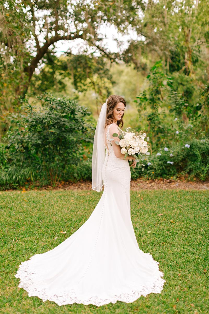Caitlin in her Stella York wedding dress holding her Alta Fleura bouquet