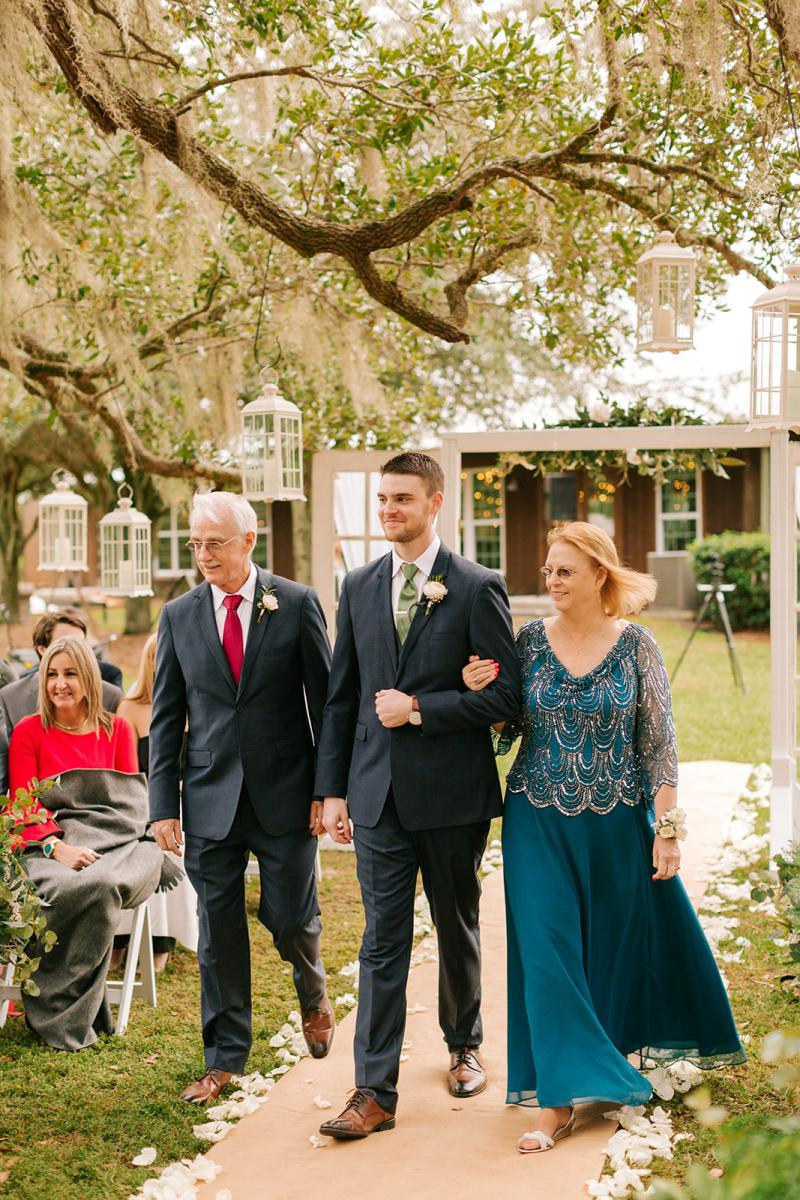 Michael and his parents walking down the aisle