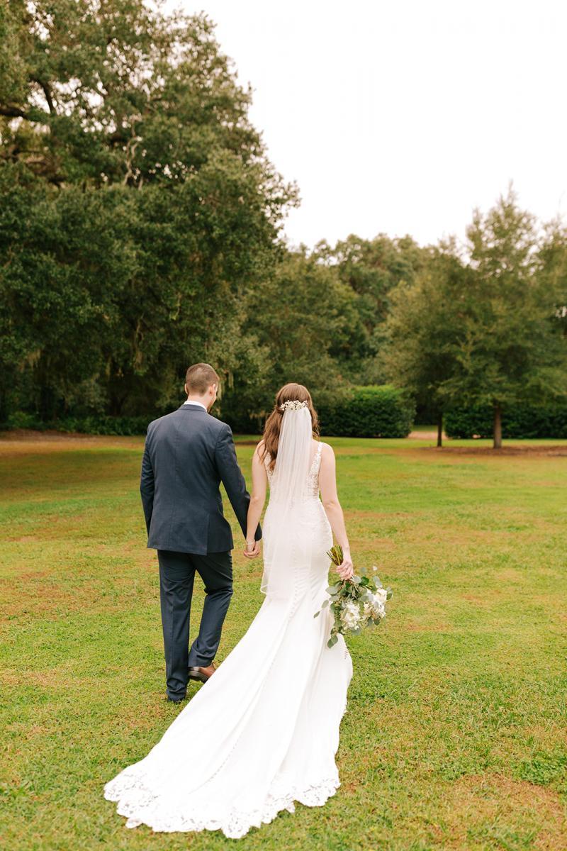 Caitlin & Michael walking hand in hand