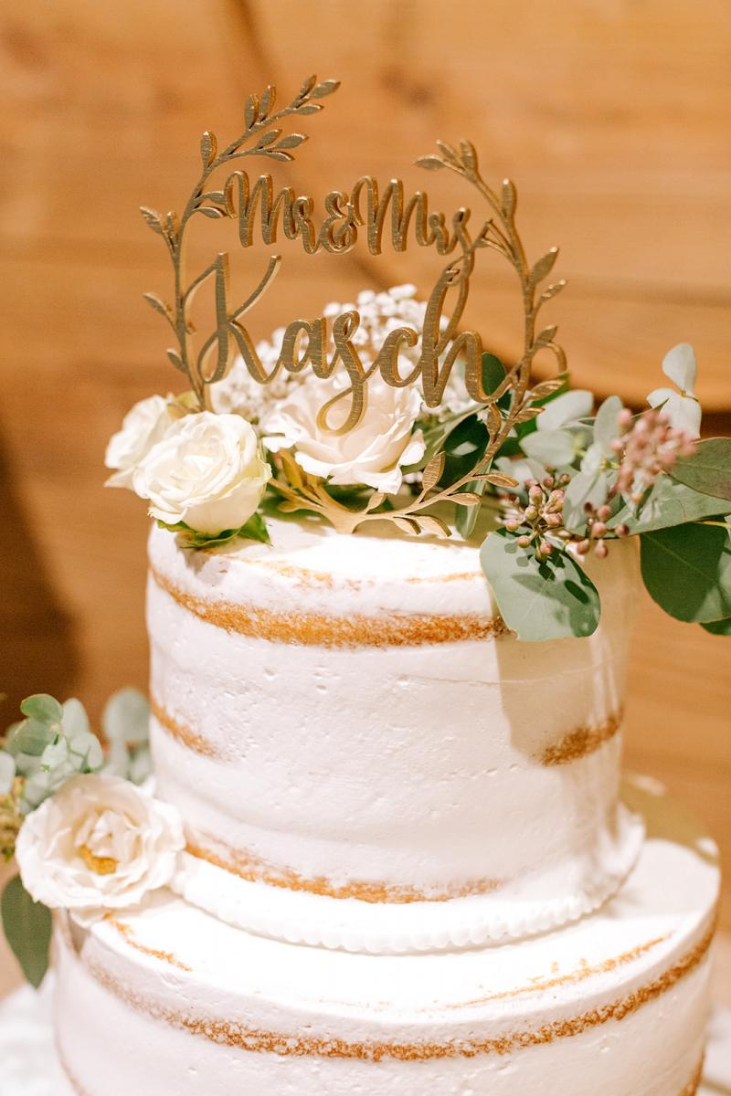 Gold scripted personalized wedding cake topper
