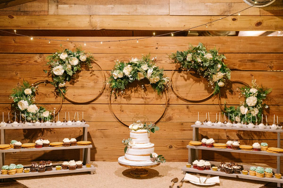 Sage green and white rustic wedding cake table