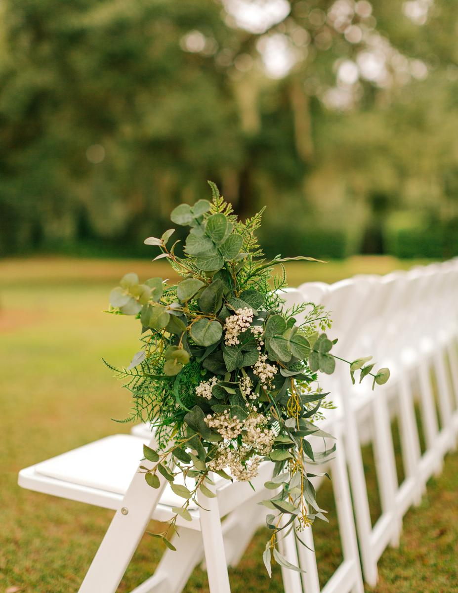 Bundles of greenery for the ceremony aisle decor