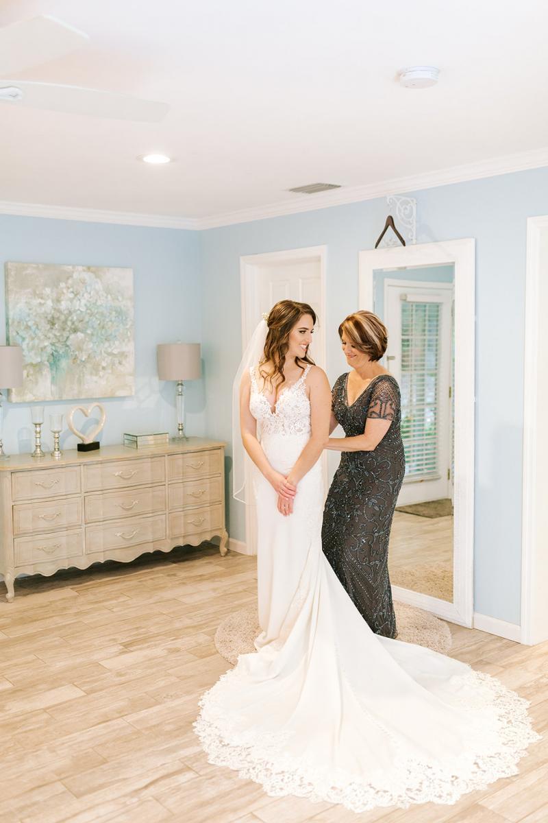 Caitlin's mom getting Caitlin's dress on
