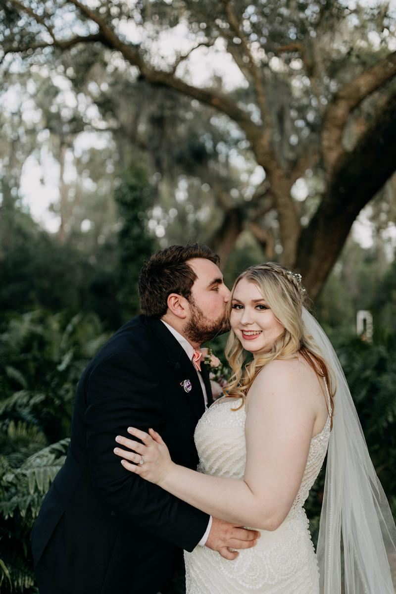 Sweet kisses from the groom