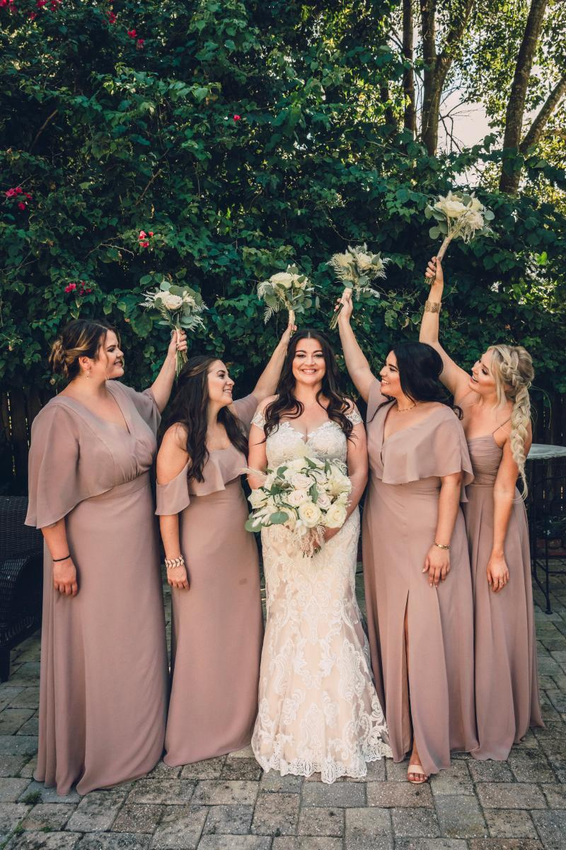 Long mauve bridesmaid dresses from Allure