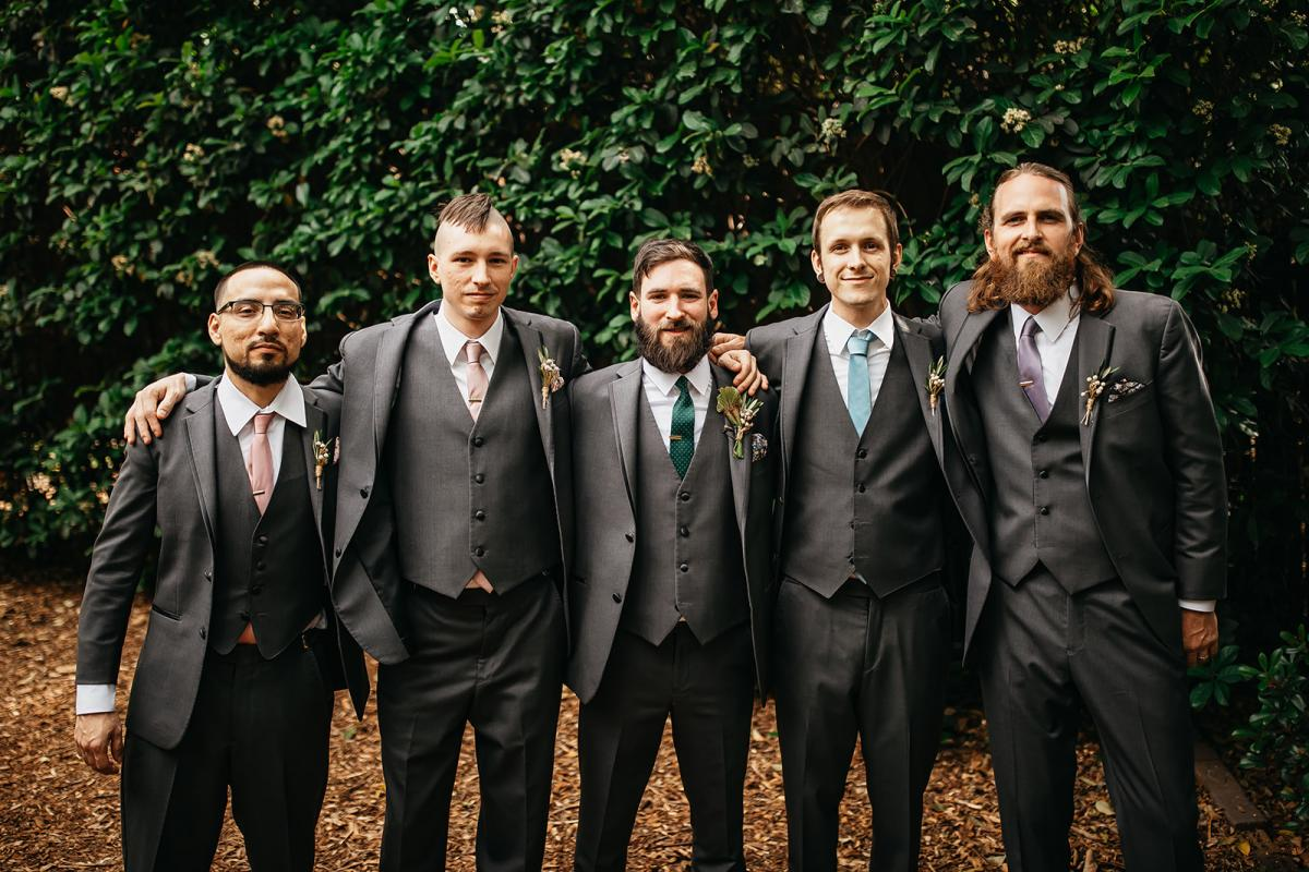 Chris and his groomsmen in charcoal suits