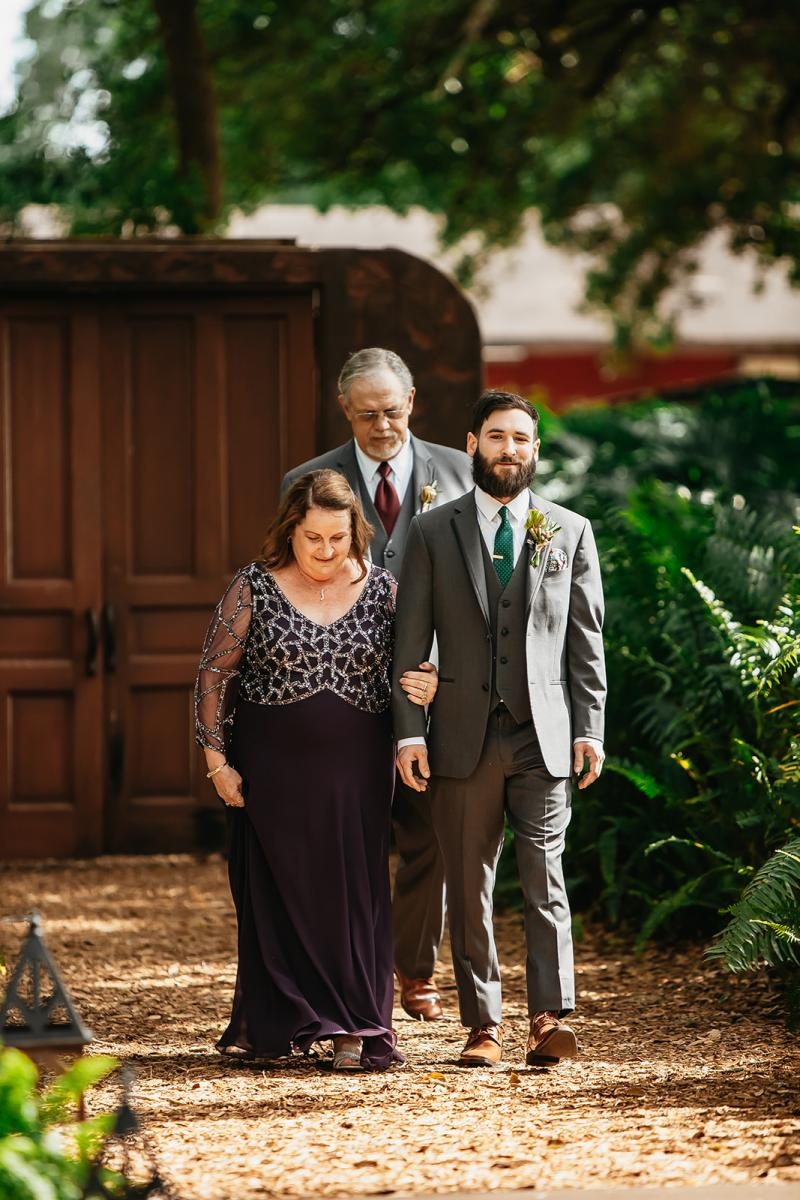 Chris and his parents walking down the aisle