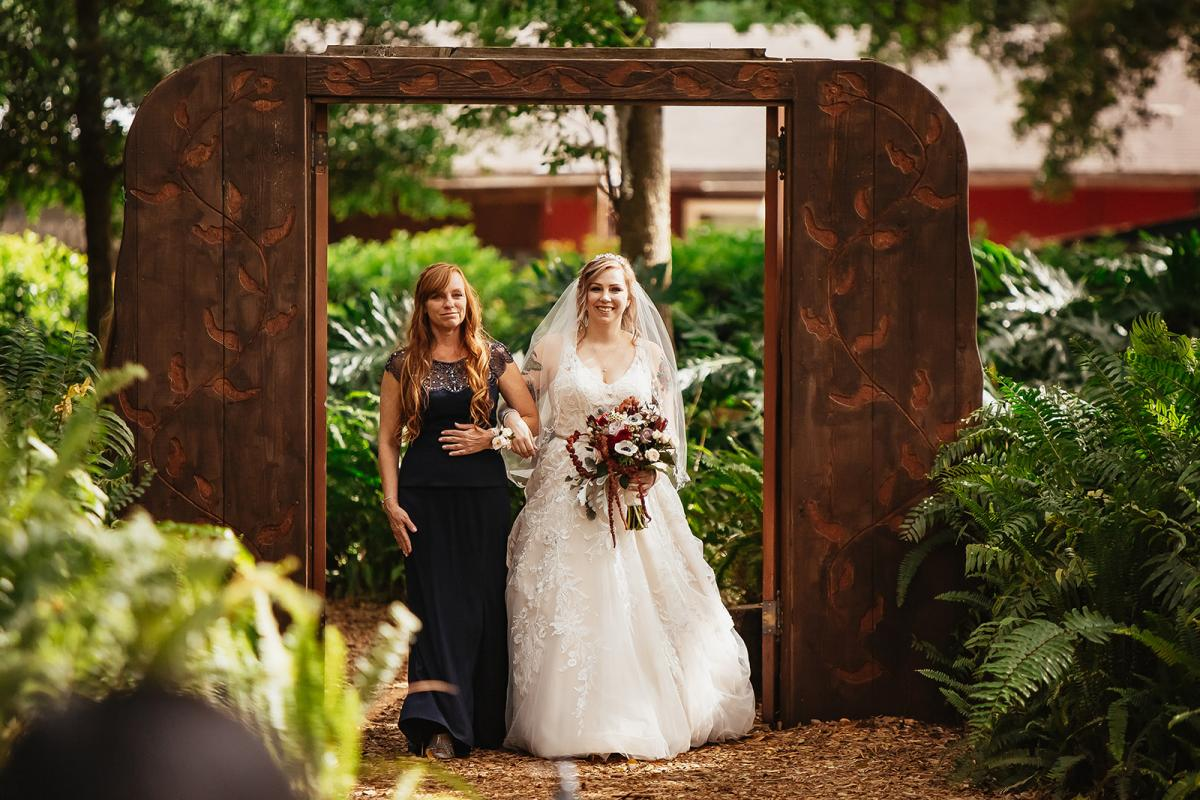 Shanna and her mom walking down the aisle