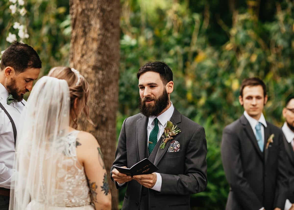 Chris reciting his vows during their ceremony