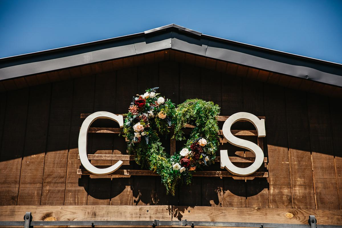 Shanna and Chris's wedding initials on top of the Carriage House Stable