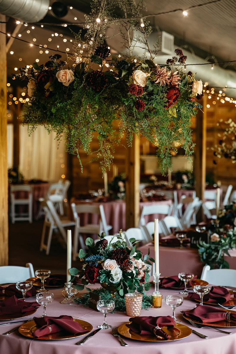 Hanging greenery garlands above guest tables