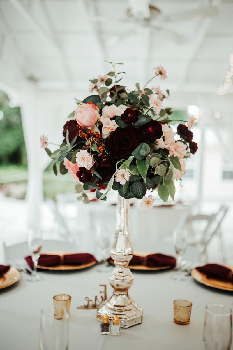 Tall wedding centerpieces with burgundy and blush flowers