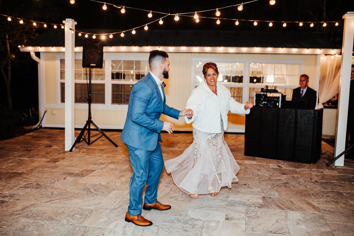Carlos dancing with his mother
