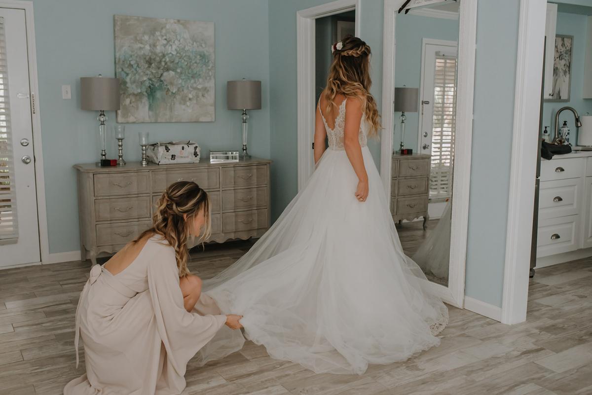 Kirstin putting her dress on