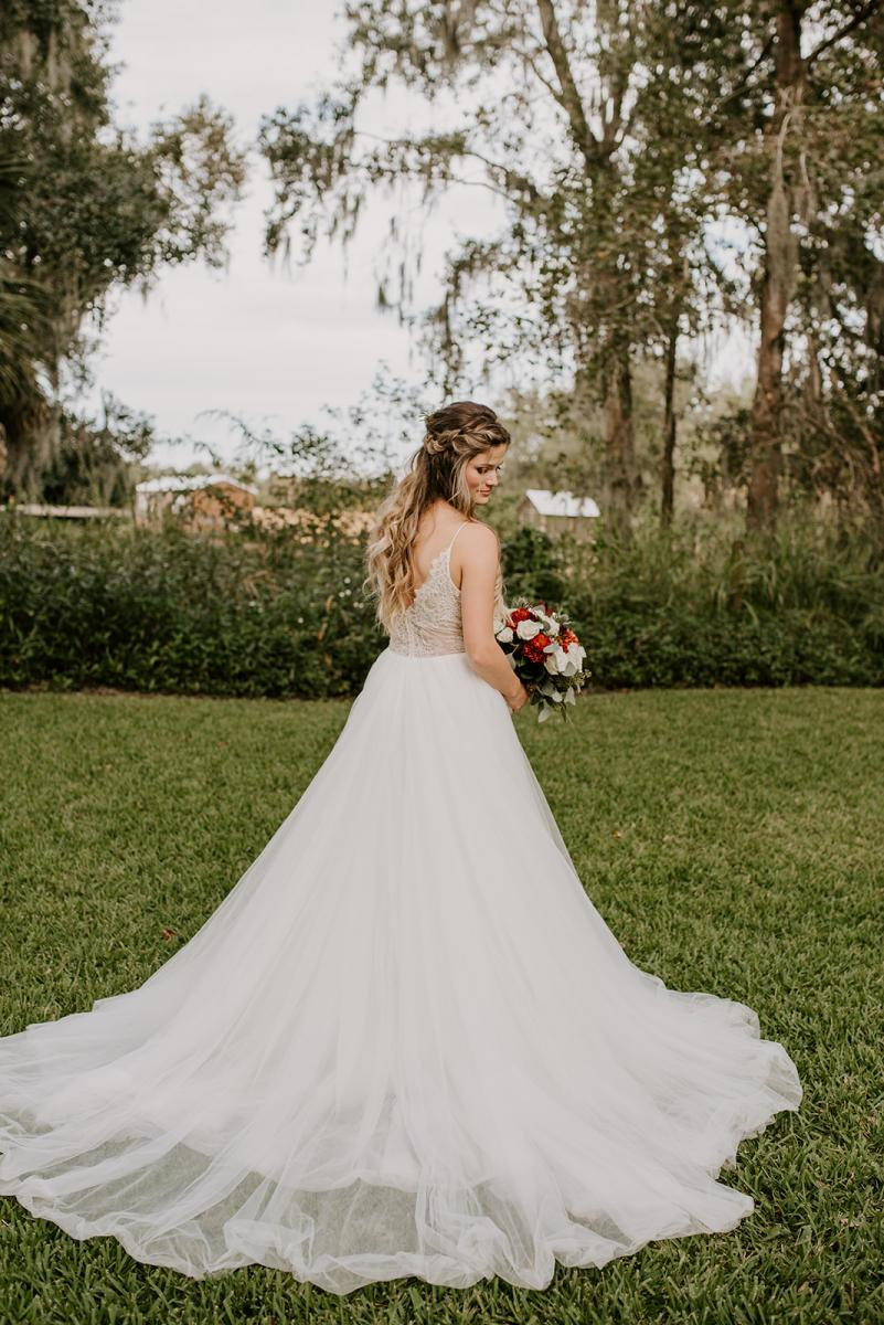 Kirstin looks gorgeous in her whit flowy bridal gown