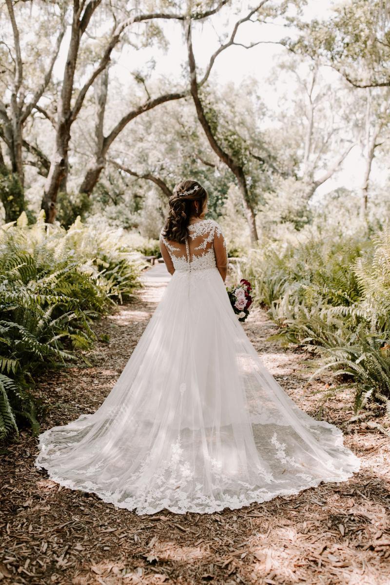 The back of Bella's Essence of Australia wedding dress