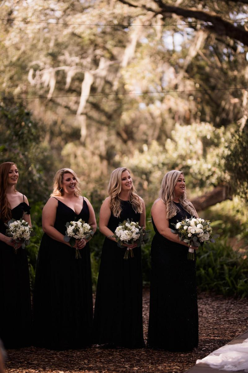 Gorgeous bridesmaids dressed in long black dresses