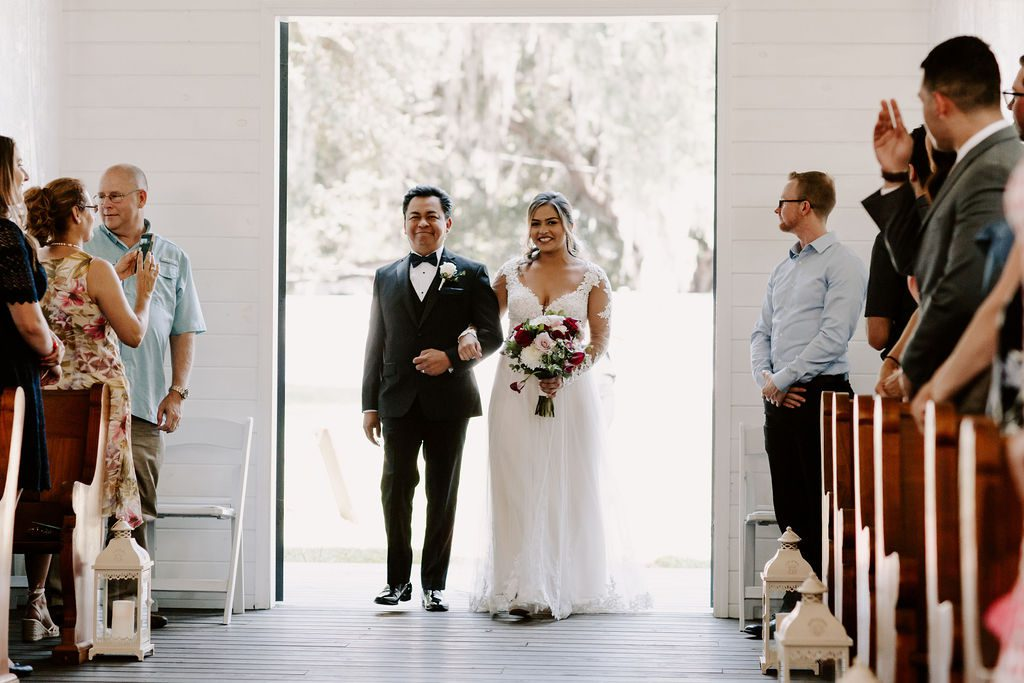 Bella walking down the aisle with her dad