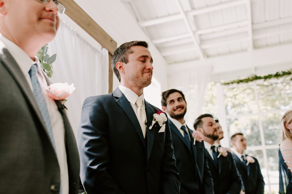 Benjamin's expression as he sees Bella walking down the aisle