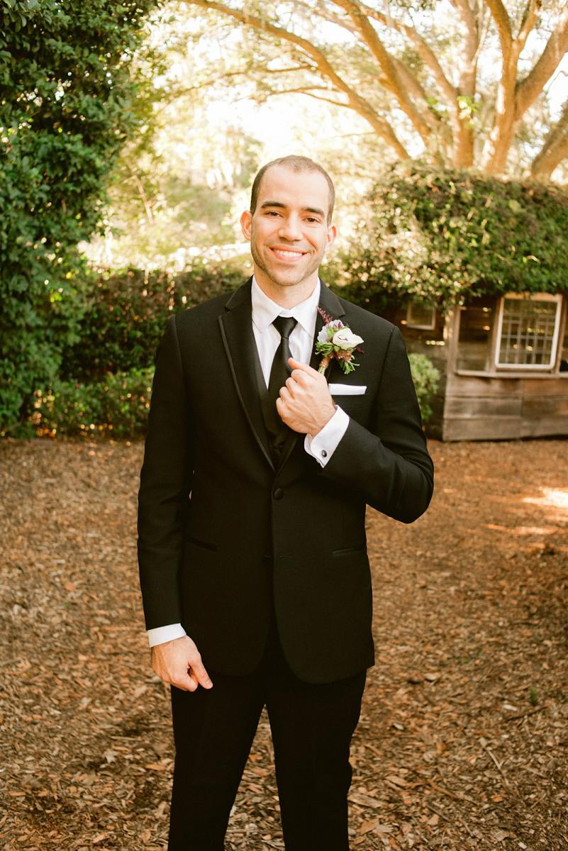 Danny dressed in a modern groom's suit