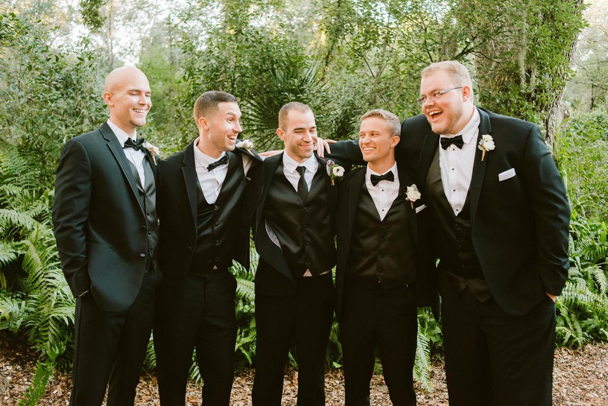 Danny and his groomsmen in black suit and tie