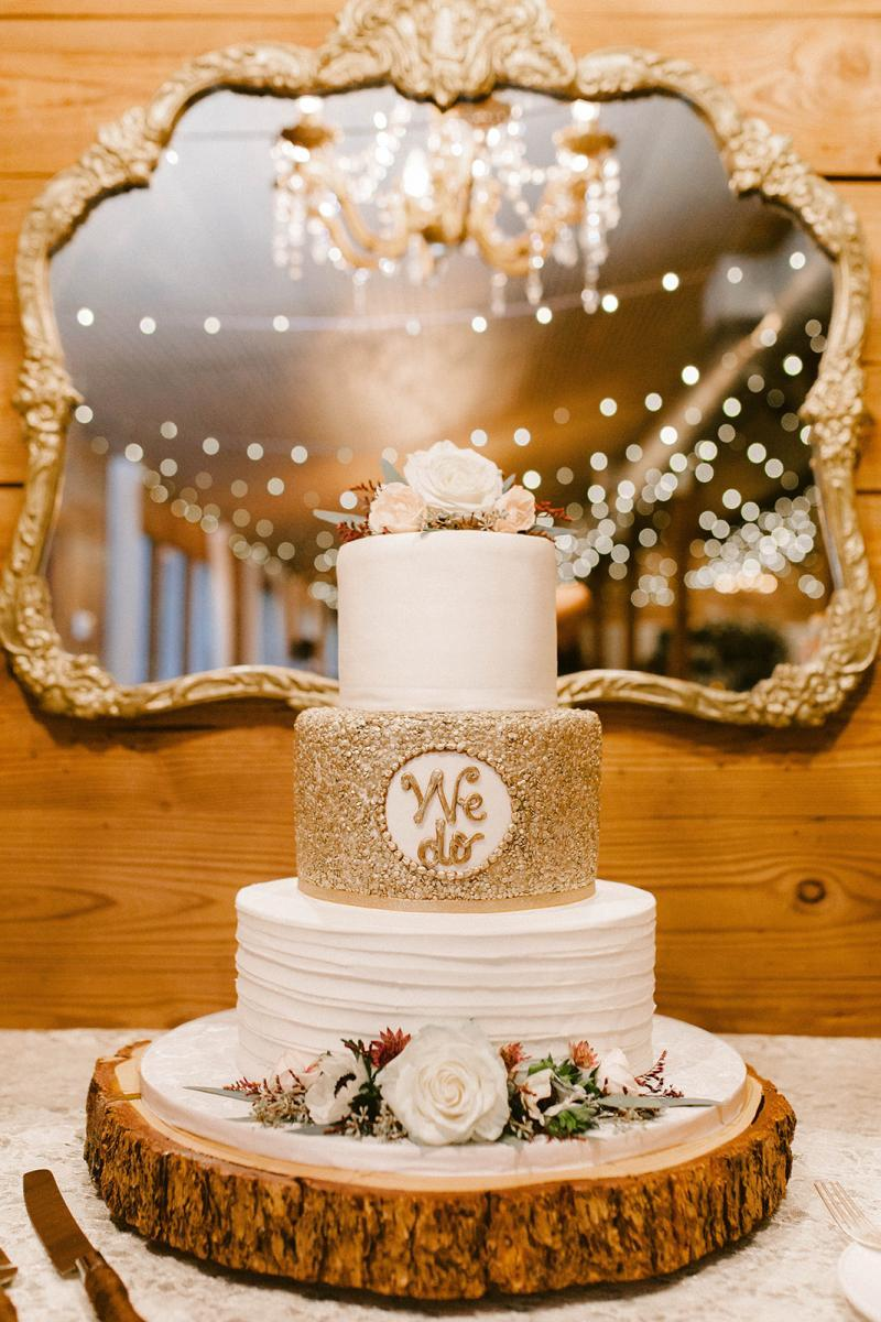 Modern romantic wedding cake with elegant gold glitter