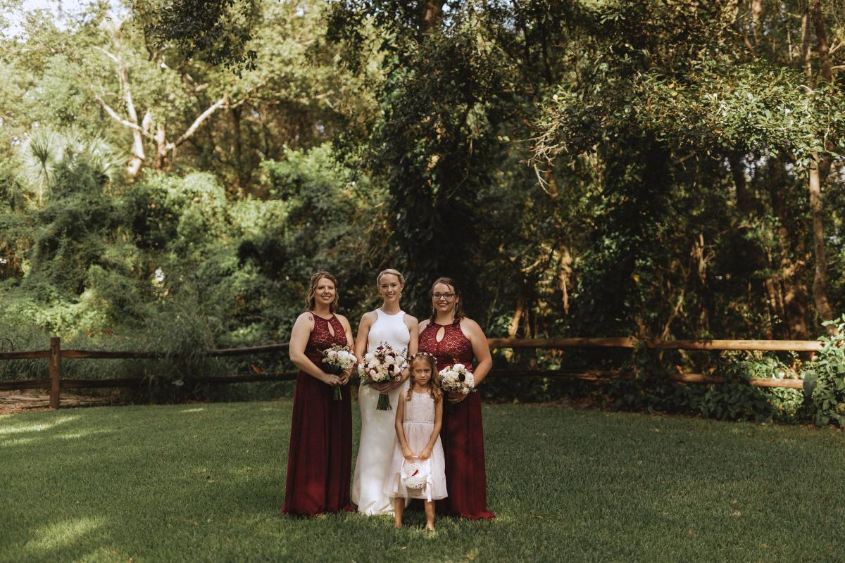 Katie's bridesmaids in cranberry dresses