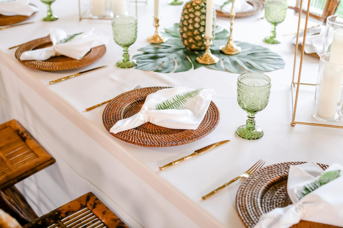 Bamboo chargers, bamboo flatware and green goblets for the fresh tropical styled shoot