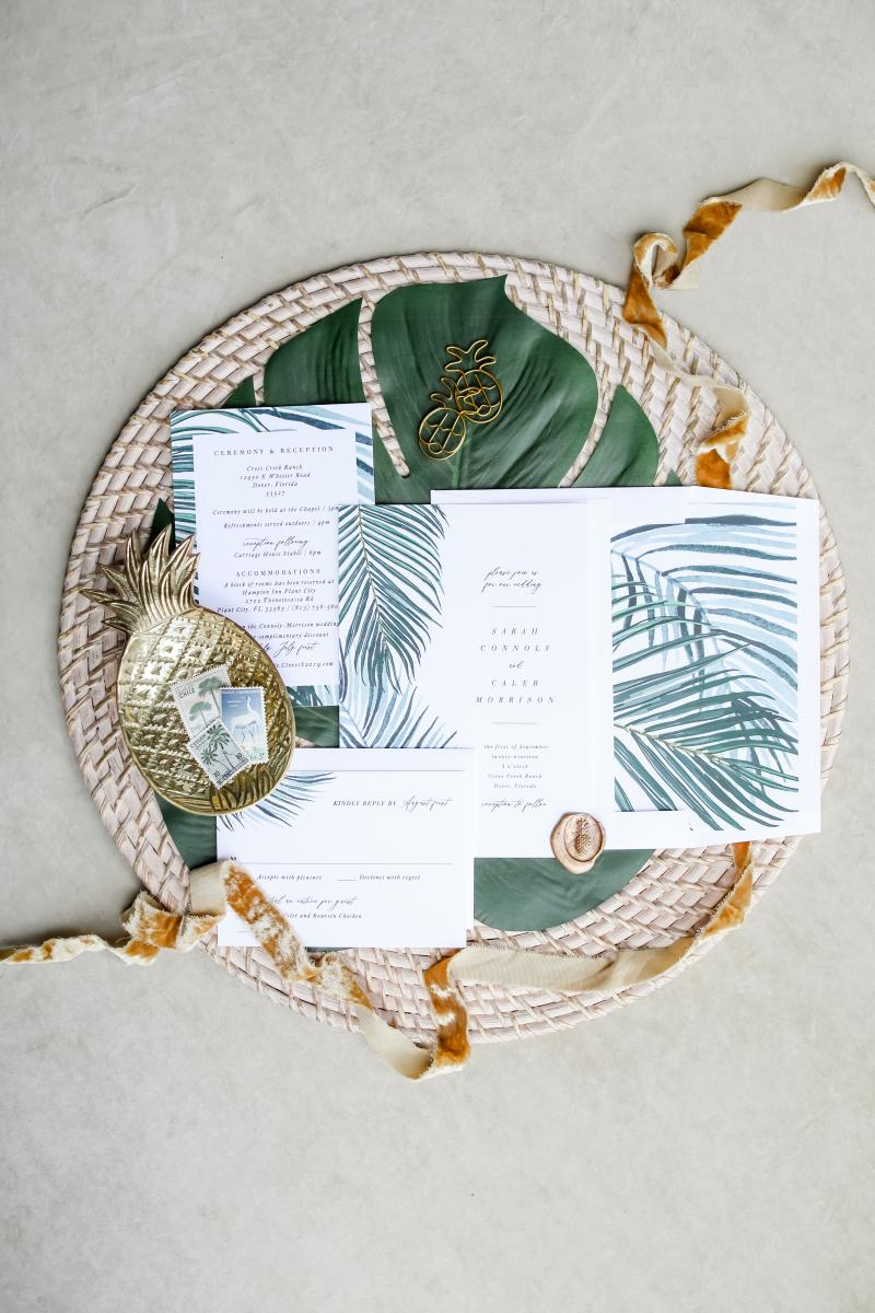Tropical invitation suites with palm leaf print