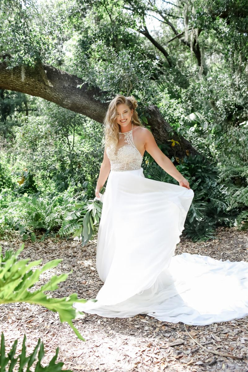Flowy, high neck wedding gown by The White Closet Bridal Company
