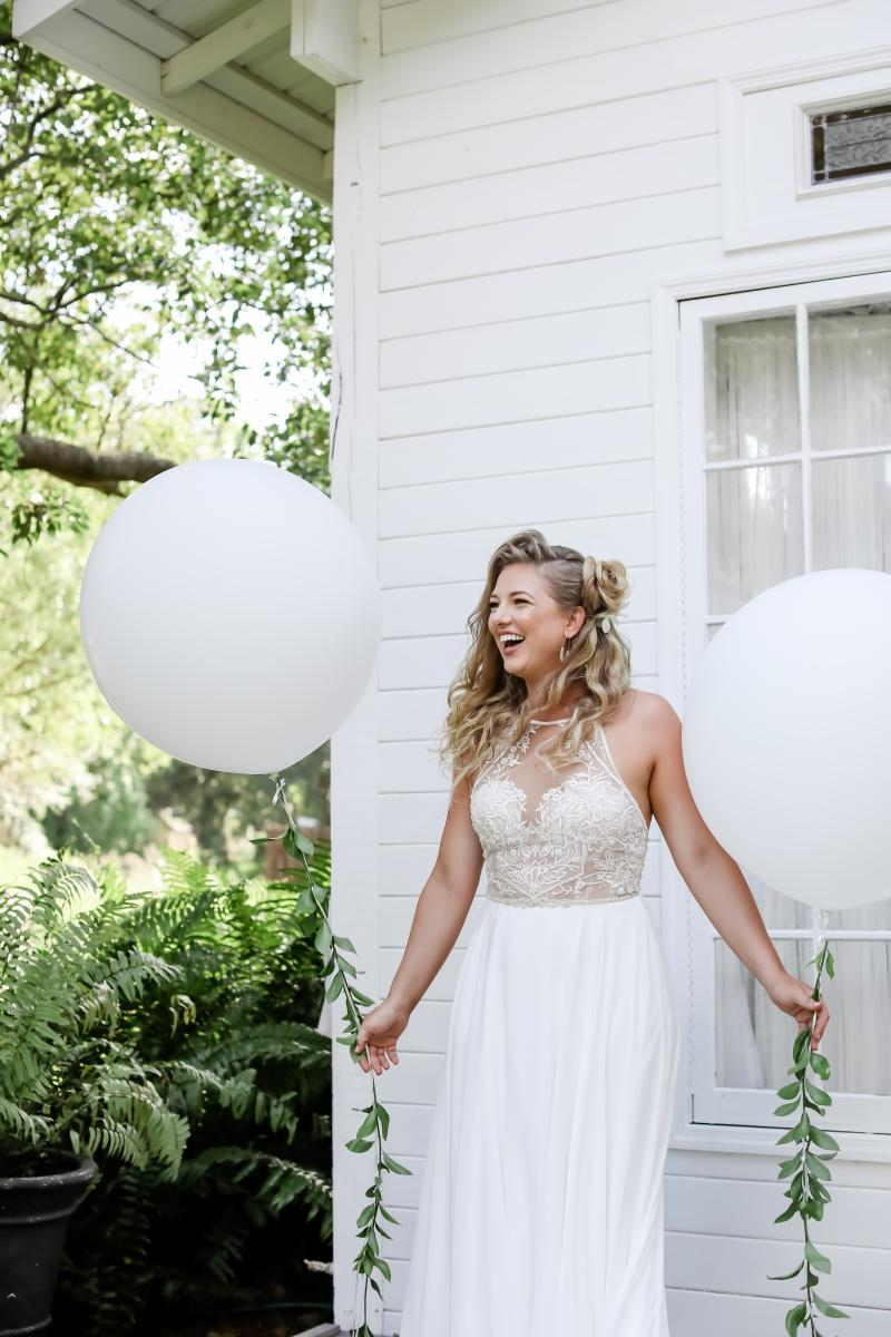 Festive white large balloons as props for this fresh tropical styled shoot