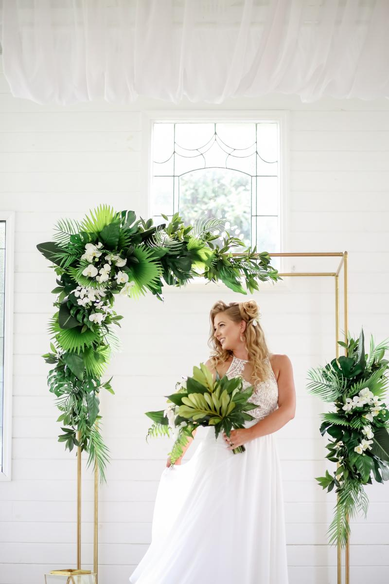 Tropical ceremony arch decor