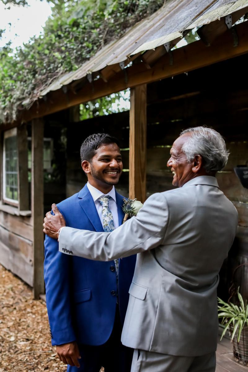 Raj and his father getting ready for the wedding