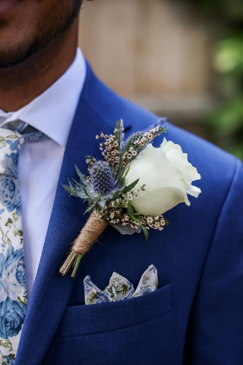 Garden inspired wedding boutonniere for the groom