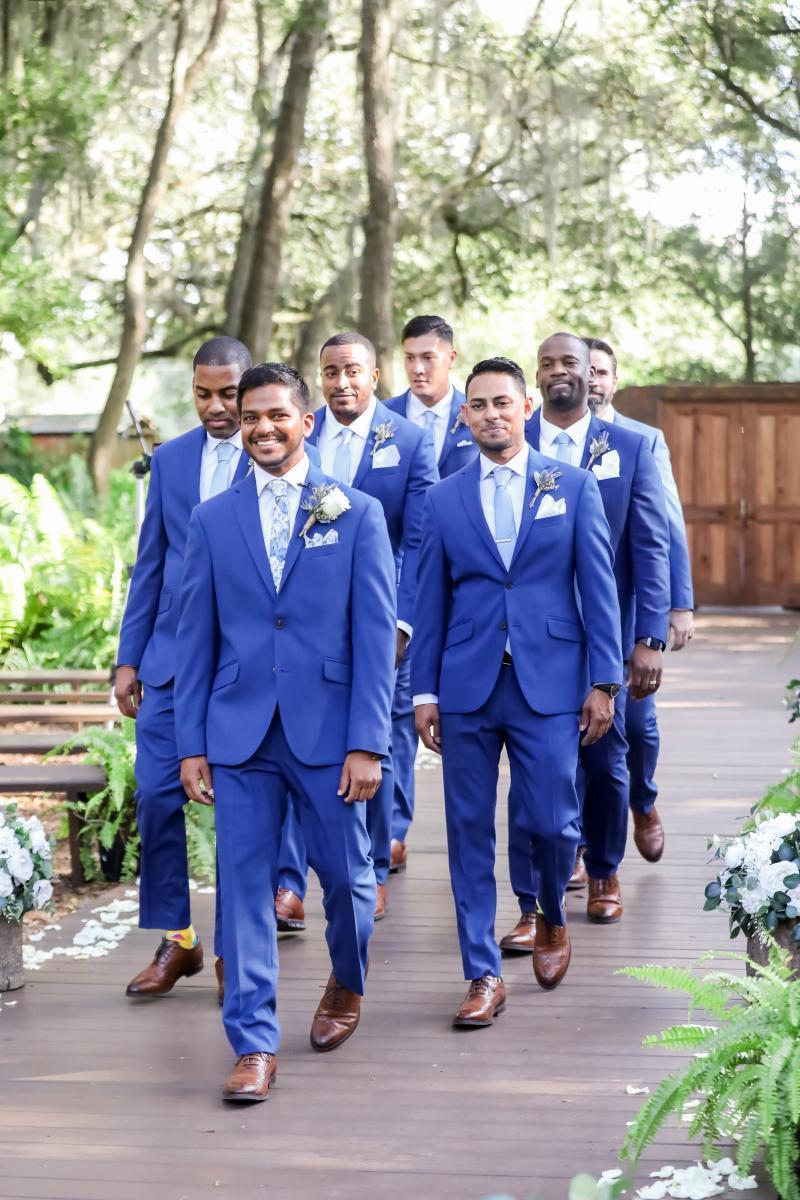 Raj and his groomsmen walking down the aisle