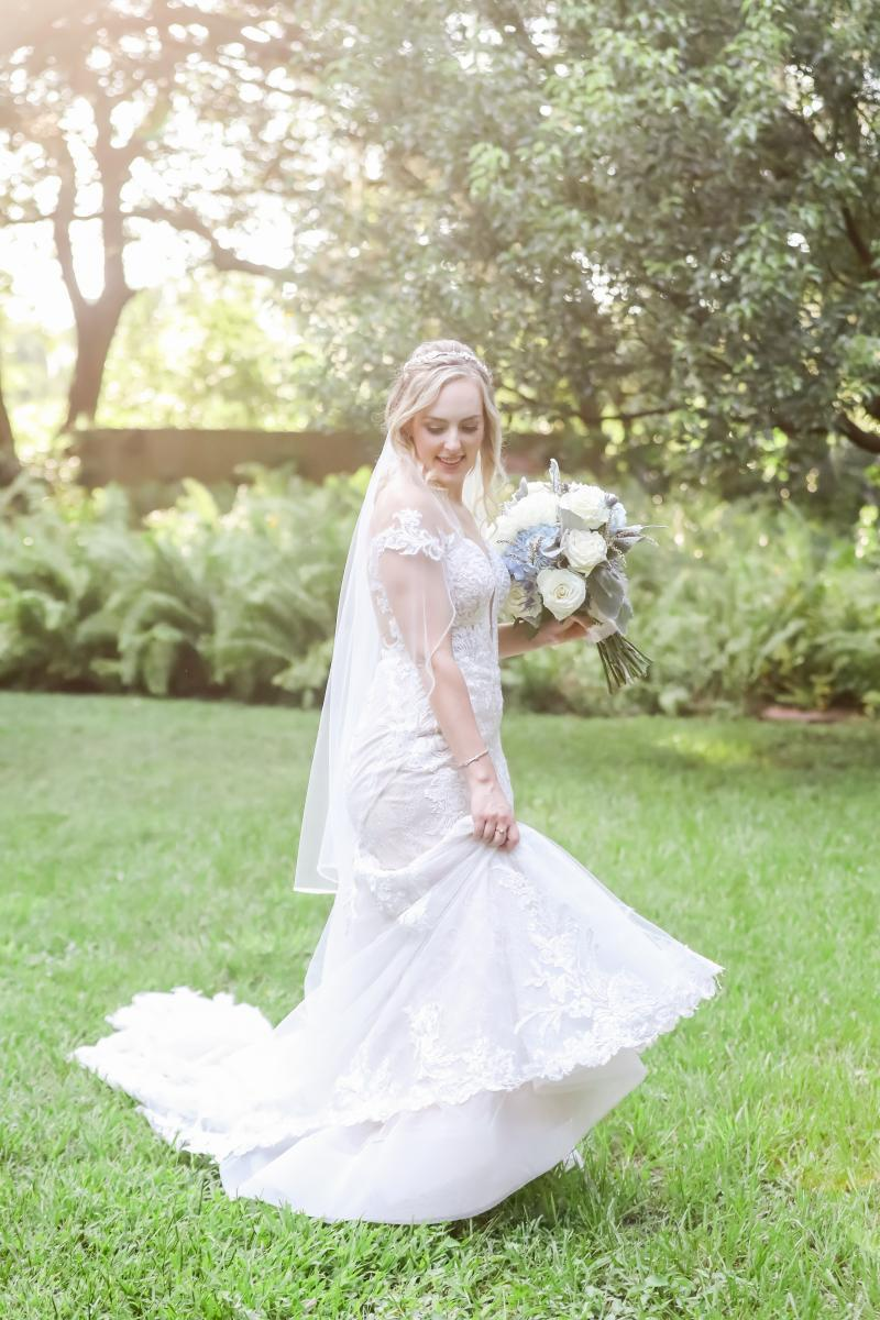 Off the shoulder fit and flair wedding dress