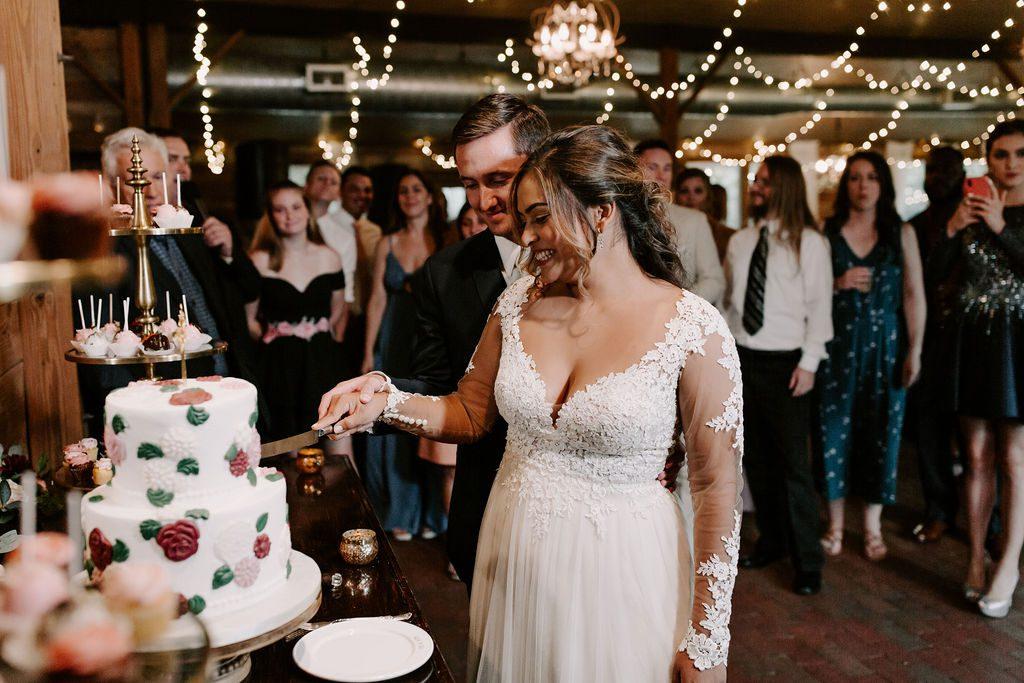 Bella and Benjamin cutting the cake