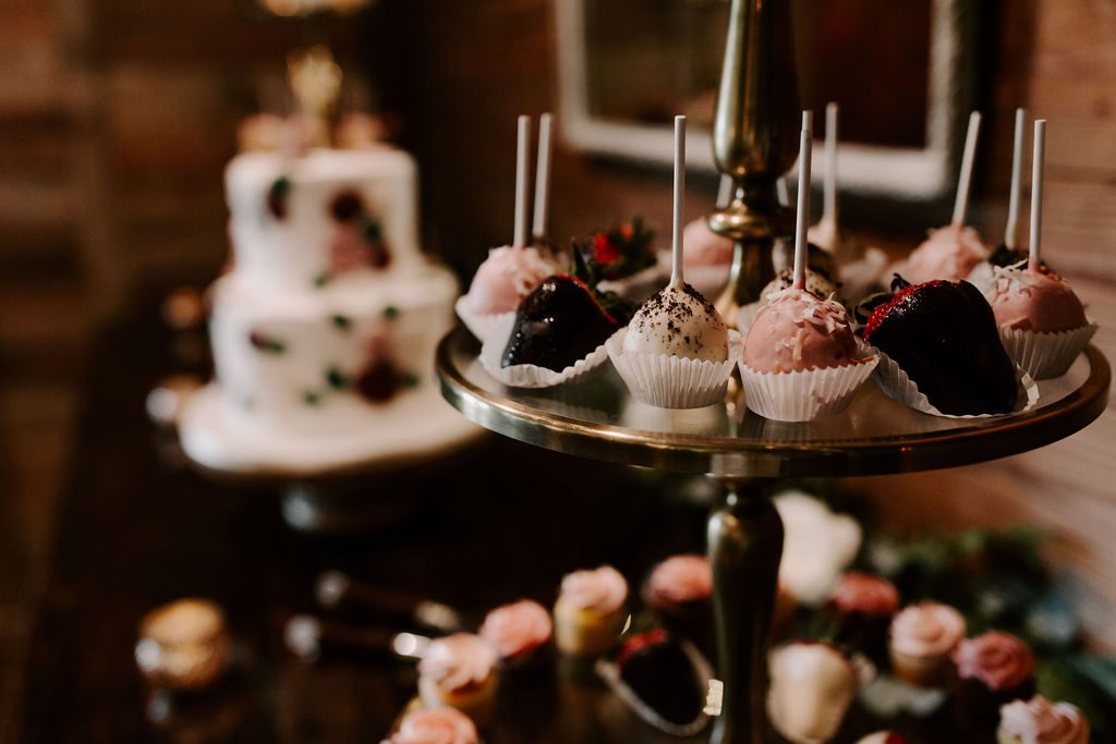 Wedding desserts displayed on the cake table