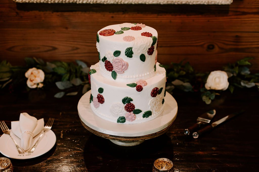 Two-tier wedding cake with floral applique design